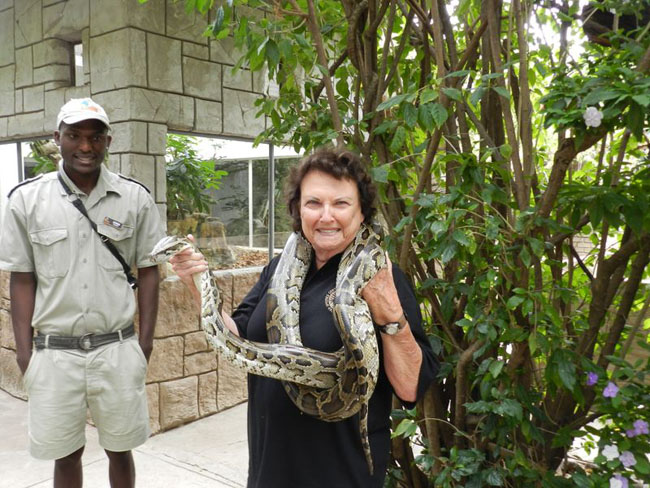 Pat holding a python at Khamai Reptile Park with Given one of the guides